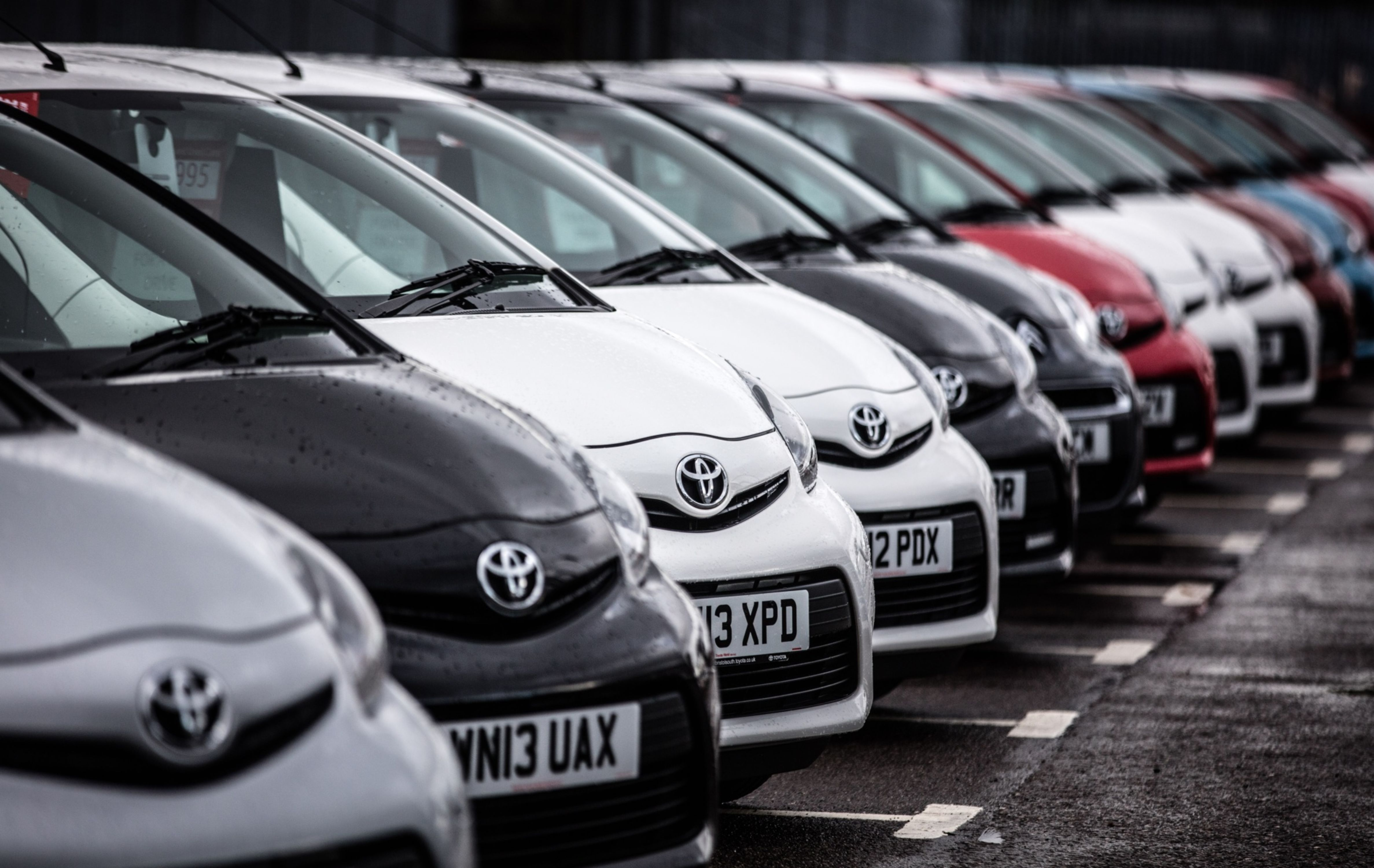 A line of Toyota cars are offered for sale on the forecourt of a main motor car dealer in Brislington on October 6, 2015 in Bristol, England.