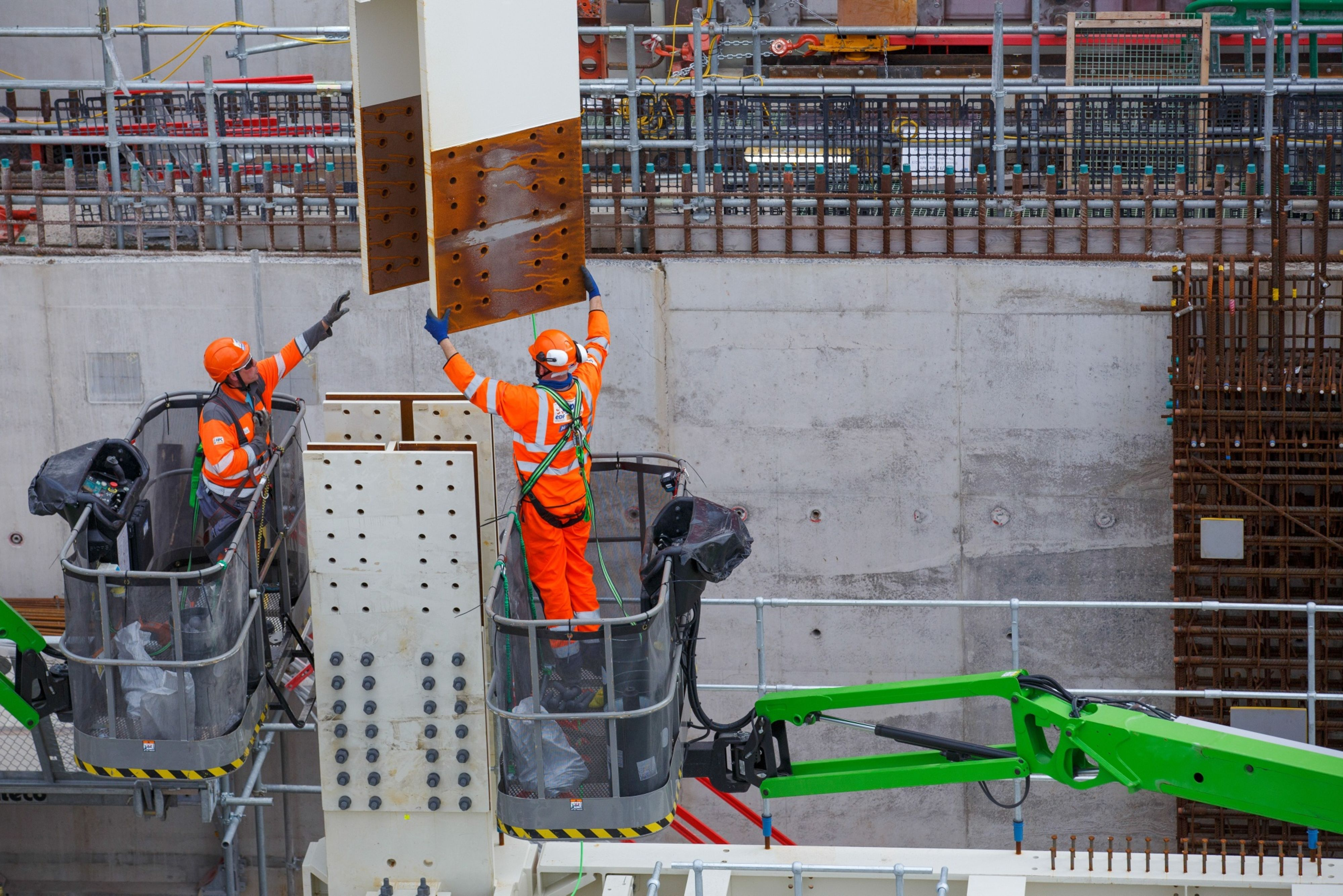 Contractors move a steel joist into position at Hinkley Point C nuclear power station construction site, near Bridgwater U.K., on Thursday, Sept. 23, 2021.